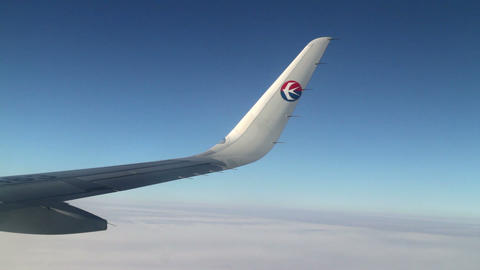 Aerial View With The Wing Of China Eastern Airline's Plane. HD stock footage