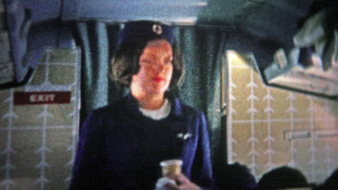 CHICAGO - 1966: Stewardess On An International Flight On An Airplane Bound For E stock footage