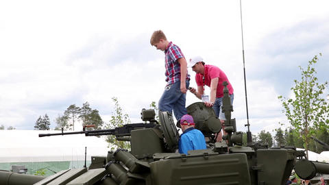 Kids On Military Tank. International Military Technical Forum Army-2015 stock footage