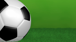 Green Background With Spinning Soccer Ball stock footage
