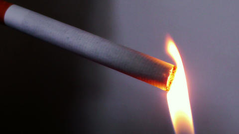 lighting a cigar ( cigarette) - soft slow motion Footage