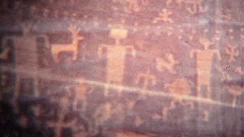 1972: Alien Cave Drawings Of Human Like Figures And Symbols stock footage