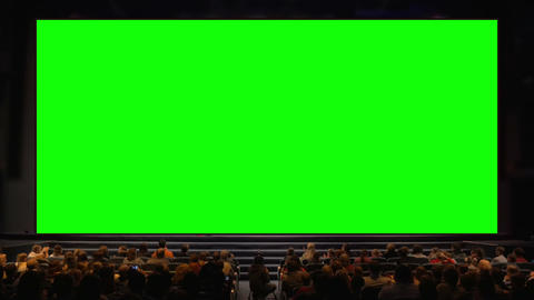People in the auditorium with chroma key screen Footage