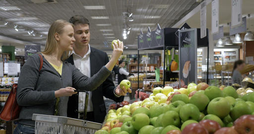 Young People Choosing Apples In The Supermarket stock footage