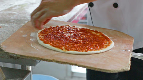 HD Footage Closeup hand of chef baker making pizza at kitchen Footage