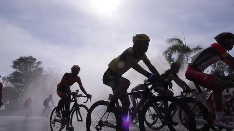 Cyclist Ride Through Water Spray stock footage