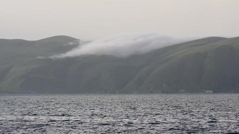 Ocean At Dusk With Misty Hills stock footage