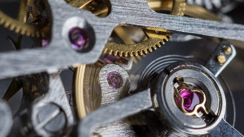 Closeup shot of the interior of a watch with spinning gear wheels Footage