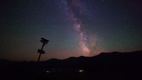 Milky Way Galaxy Over The Mountains. Time Lapse stock footage