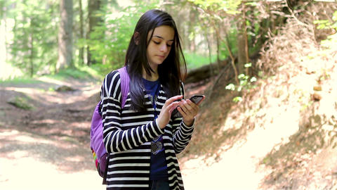 Young girl tourist using smartphone Footage