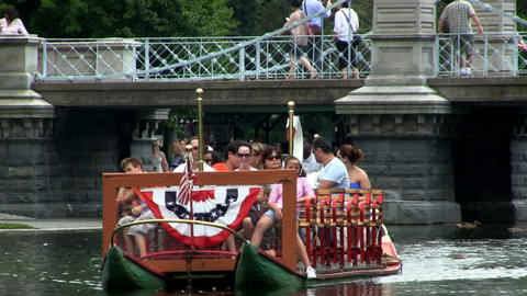 Tourists And Visitors Ride Swan Boats At Boston Public Garden. The Operators Ped stock footage