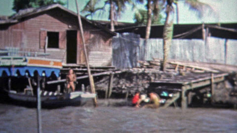 1973: Fast Boat Ride Thru Rural Southeast Asian Waterway Countryside stock footage