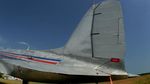 A Tail Of A DC-3 Transport Aircraft Parked On Grass At Cape Cod Airfield Against stock footage
