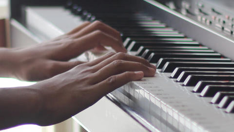 A Child's Hand Playing The Piano stock footage