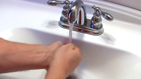 Man Washes Hands; 2 stock footage