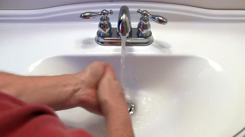 Man Washes Hands stock footage