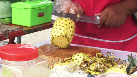 Woman Cutting Pineapple Footage
