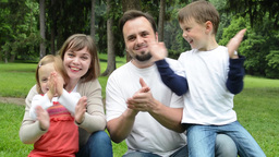Family (middle Couple In Love, Cute Girl And Small Boy) Together Clap One's Hand stock footage