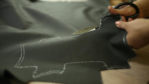 Car Service Station: The Scissors Are Cut The Leather For The Car Steering Wheel stock footage