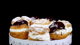 Delicious Chocolate And Powder Flavored Cream Puffs stock footage