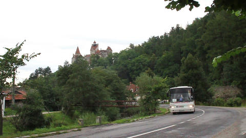 Romania. Bran. Dracula Castle. Bus On Road stock footage