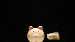 Shooting Arrow To The Dollar On Piggy Bank stock footage