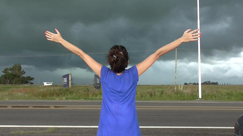 Woman Watching Storm stock footage