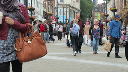 People Move Along Briggate, Leeds stock footage