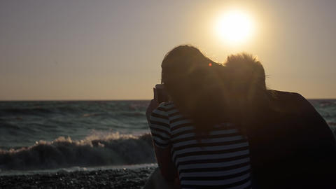 Silhouette Of Couple On The Beach Looking Out To Sea stock footage