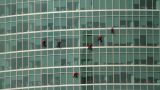 Climbers On A Skyscraper stock footage