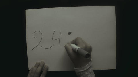 Child's Hand Writing On A White Sheet Of A Top View 24 : 4 = 6 stock footage