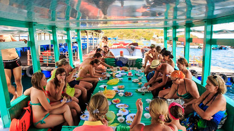 Tourists Take Meal At Large Table On Special Tourist Vessel stock footage