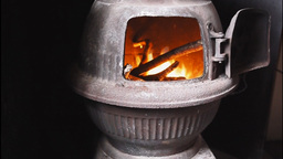 Fire In A Pot Belly Stove stock footage