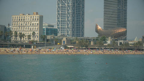 Detail Of Barceloneta Beach And Barcelona Sky Line From The Sea stock footage