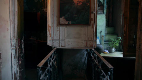 Old Building Interior With An Vintage Fidel Castro Picture And Stairs stock footage