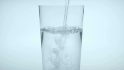 Water Being Poured Into A Cup stock footage