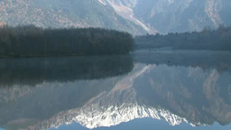 Snow Covered Mountains Reflected On Lake stock footage