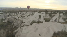 Balloon Floating Over Rocky Valley In Cappadocia, Turkey stock footage