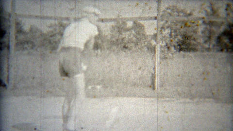 1937: Tennis play complete with judge on stand and parked cars Footage