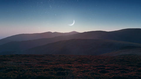 Setting Moon Over The Mountains stock footage