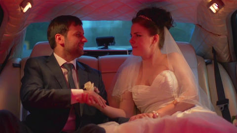 European Wedding, The Bride And Groom Kissing In Limo stock footage