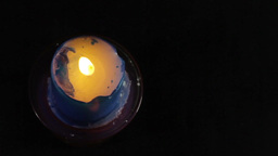 A Blue Candle On A Black Background stock footage