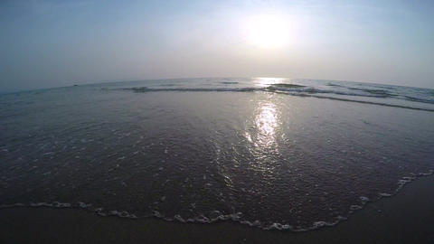Gentle Ocean Waves with Sunset Zooming Out Footage
