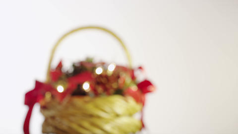 Christmas basket with berries, leaves, pine cones and garland Footage