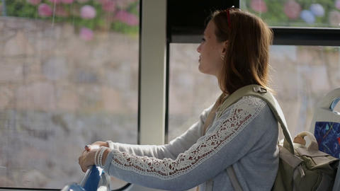 Young Woman Tourist Go By Bus With Backpack Sitting Indoors, Looking In Window stock footage