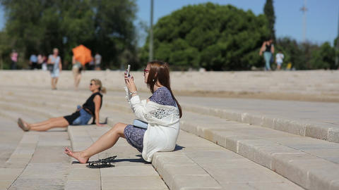 Teenage Girl Takeing Photo At The Amphitheater Of Belem In Portugal stock footage
