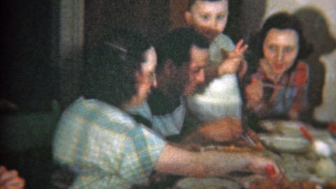 1951: Big Family At Crowded Dinner Table Eat Italian Food stock footage