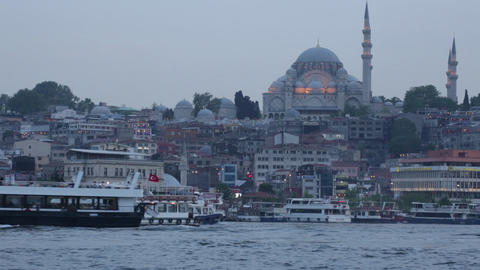 Tourist Ships In The Passage The Gold Horn Against The Mosque Suleymaniye stock footage