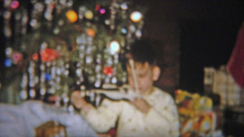 1954: Boy Gets A Violin For Christmas, Plays It Like A Professional stock footage