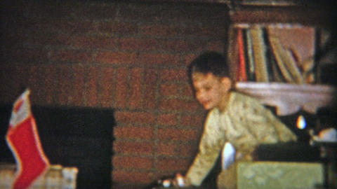 1954: Older Brother Teaching Toddler About How To Play With Guns Indoors stock footage
